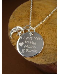 """Hand engraved solid sterling silver pendant ("""" I love you the the Moon and Back"""" ) and sterling silver moon and star charm on sterling silver chain link necklace. Available necklace lengths: choose between 16, 18 or 20 inches."""