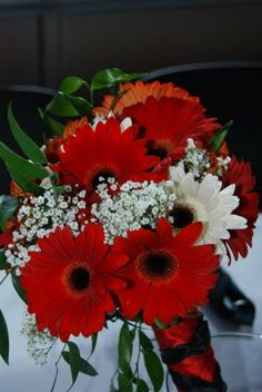 babys breath and red poppy center pieces | bridesmaid bouquets were red and white Gerbera daisies, baby's breath ...