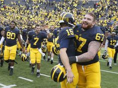 Michigan quarterback Jake Rudock gets a hug from and