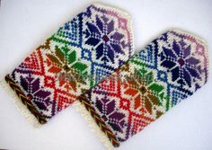 Completely original high quality hand-knittted wool mittens,colors of the rainbow tinted stars ornament on a white background