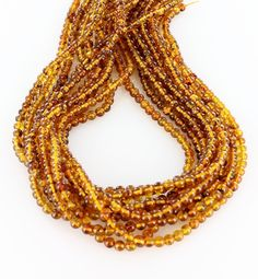 "Geniuine Baltic Amber beads cut in 5mm round size with plant and insect inclusions. 16"" strands sold separately. Please note: This is not a finished necklace, these beads are temporarily strung."