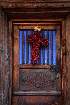 Jalapeno Greeting   Artist: Jim Benest   Dried red peppers fashioned into a cross evoke a traditional Christmas in Santa Fe.  1% or more of the profits from my work goes to support International League of Conservation Photographers   http://www.artforconservation.org/store/product_details.php?pr=2192