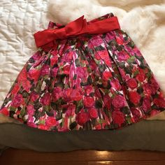 Cute floral mini skirt with tulle Adorable floral mini skirt cute with a white tank. Added tulle underneath for great fit and flare style. Bow ties around the top or can be removed. Forever 21 Skirts Mini