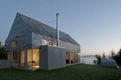 Martin-Lancaster House / MacKay-Lyons Sweetapple Architects | ArchDailyThe Martin-Lancaster house is a 3000 square foot courtyard house, situated on the rugged Atlantic coast of Nova Scotia. It consists of four primary components: (1) a gabled garage/guest house, (2) a gabled social pavilion, (3) a north-facing service bar, and (4) an arrival court between.