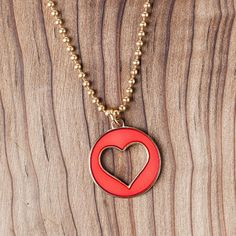 "Tell a loved one ""I love you,"" with this stylish necklace that gives to a good cause."