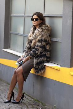 Christine Centenera balances a heavy fur coat with a slinky pencil skirt and pumps