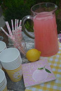 Cute striped yellow cups and pink polka dotted straws. links to printables
