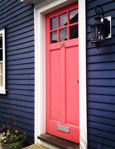 navy exterior, coral front door
