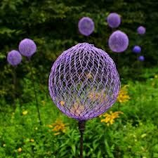 intermingle these wire orbs on sticks with gladiator alliums for a trippy effect