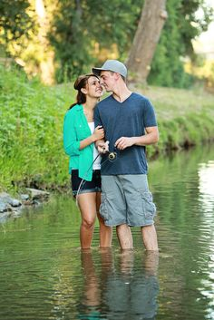 Fishing engagement photos - good for her for getting in the water!