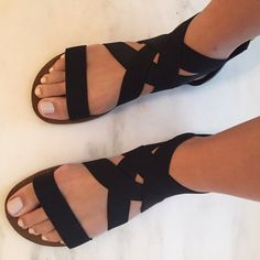 Hokus Pokus DSW Black Elastic Gladiator Sandals Black gladiator sandals. Gently used. Slight wear on toe but barely noticeable. Great black flat sandals! Back is black leather with zipper closure. Hokus Pokus Shoes Sandals