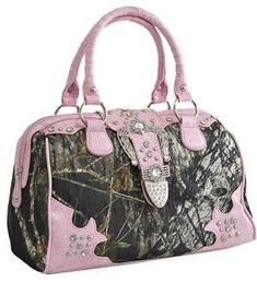 """Mossy Oak Camo Print w/Buckle Shoulder Bag HANDBAG PURSE - MO/PINK. Size : 13(L) X 5.5(W) X 10(H). Flap w/magnetic snap closure. Material: Camouflage with leather trim & Rhinestone w/studs. Double handles have a 5"""" drop & Detachable long strap included. Rear zip pocket, One wall zip pocket and two pouch pocket inside & Fabric lining."""