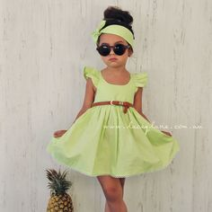 Indie Fairy Dress by Lacey Lane  -Lime Green fabric  -Frill Sleeved adjustable straps  -Elastic back   -Belt Loops (belt and detachable bow sold seperately)  -100% cotton  -Regular fit   Model is wearing a size 3.  Belt, Bow and Accessories sold separately.