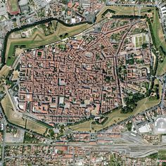 Lucca, Italy. Walled town which cyclists can circle along the top of the wide walls. Several bike rental stands just outside the walls.