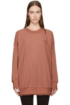Long sleeve waffle knit cotton sweatshirt in 'raw' pink. Rib knit crewneck collar, cuffs, and hem. Logo embroidered at bust. Signature tonal grosgrain stripes at shoulders and sleeves. Dropped shoulders. Raw-edged tonal waffle knit underlay at cuffs and hem. Tonal stitching.