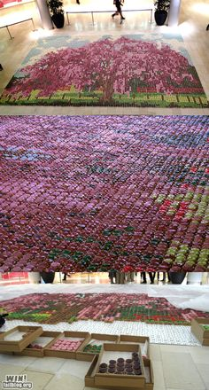 Amazing level of creativity. And patience! The mosaic is made of cupcakes!