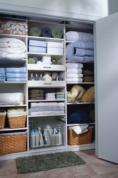 Contemporary Closet with Built-in bookshelf, Linen closet, Daltile Cement Tile Diamante in Ghiaccio, High ceiling