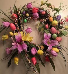 Spring is coming! And what do we think of with spring ? Spring flowers and Easter ! This design includes plenty of both . Tulips and lilies share the floral spotlight in the design. The design starts with an eighteen inch grapevine wreath. The first layer of the design are sprays of