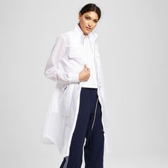 Make a fashion statement in the Women's Mesh Anorak Jacket in White by Mossimo™. With a surprising mesh fabric, this women's duster-length jacket is an instant delight and powerful piece.