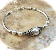 Brazalete de perlas enjaulada en racimo de plata 950