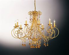 "608/10 OL amber - 10 lights  Finish: 24K Gold or Chrome  Dimensions: Ø 41"" H 33""  Colors: Clear, Amber, Bordeaux, Black, Violet"