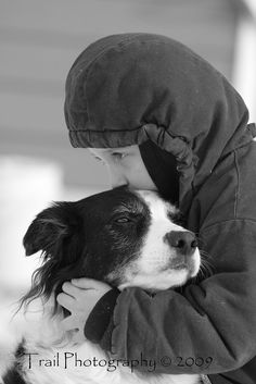 "Border Collie and his boy. This is my ""Carmen"". She is an Aussie, but both are very similar. My heart will just break, when  my baby is called home. When I hug her, and kiss her, this is her face she gives. What Love she gives me. God Love my Baby."