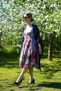 Floral wedding dress from ASOS and a cape form Topshop