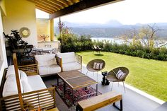 Outdoor dining/sitting space with outdoor setting looking out onto lawn. By: A Mayúscula Arquitectos
