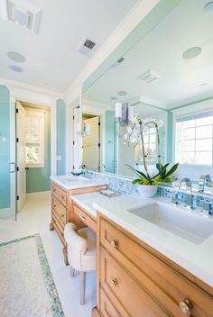 love the his/her sinks.  love the tile back splash that ties in with the floor. the built ins look like furniture.  great wood tone.  bright, airy, and a little sparkle!    House of Turquoise: Builder Boy