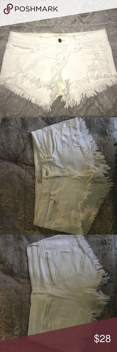 """GUESS cutoff white denim shorts White denim cutoff shorts. Fit details: 7.75"""" low front rise, 13.25% back rise, 2.5"""" inseam, and 93% cotton. From summer 2016. Guess Shorts Jean Shorts"""