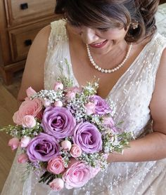 Rumy's bouquet. Lavender and pink roses, pink spray roses, white and pink Waxflower and babies breath wrapped together with a satin ribbon