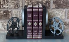 NEW COLORS - Vintage 8mm Film Reel Bookends - DVD Holder - Movie Theater Decor by LightAndTimeArt on Etsy https://www.etsy.com/listing/248890182/new-colors-vintage-8mm-film-reel