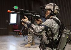 The helmet-mounted display provides a realistic virtual training platform programmable for any theater of operations while sensors on the body harness capture the soldiers movements. The natural movements are then translated to control the Soldier's avatar within the simulation.(U.S. Army photo by Maj. Penny Zamora)