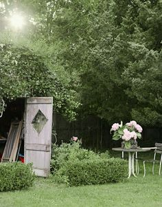 Designer Ellen O'Neill planted a garden and set up a table and chairs by the shed of her Bridgehampton home. It is the perfect accompaniment to her worn and weathered cottage.