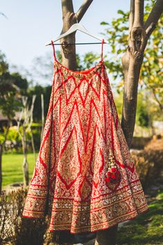 Bridal Lehengas - Classic Red Lehenga | WedMeGood Here is a Classic Red Bridal Lehenga with Gold Diamond Shaped Zardosi Embroidery all over. The Raw Silk lehenga also carried cherry red latkans! #wedmegood #bridal #lehenga