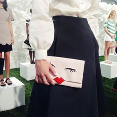 This Kate Spade purse is sealed with a kiss, and we are obsessed.