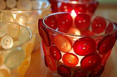 Candle holders with Buttons.  Use a hot glue.   Use semi-transparent buttons.