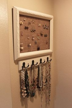 I have been wanting to organize my jewelry for awhile. It has been a heaping mess for quite some time! Here is what I came up with! Sorry, I didn't take any before photos, but I can tell you what I did, it was really easy! Supplies Old empty frame ($1.49 at Goodwill) Burlap sack (already had) spray paint (already had) hook thing for my necklaces (already had) staple gun screwdriver First I spray painted primer on my frame. It was a really ugly blue. Then I did a couple coats of my favorite…