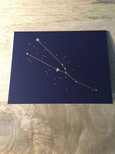 Letter press gold foil constellation greetings card birthday card for each constellation and its corresponding birthday range. Navy night sky blue card with bla