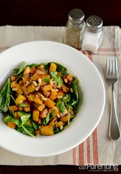 Roasted butternut squash, spinach and pine nut salad