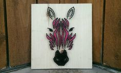This Zebra Abstract String art sign measures 11x12. Please show 3-4 weeks to complete. This piece is homemade with wood, crochet thread, nails,