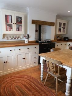 Wellie Boots and Muddy Pawprints.: Our First Home. Love these white cabinets + butcher block countertop Aga Kitchen, Kitchen Dinning, Dining Room Table, Kitchen Decor, Kitchen Design, Kitchen Ideas, Cottage Kitchens, Home Kitchens, Country Kitchens