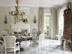 Designer Bunny Williams updated this East Coast Georgian Revival with a gorgeous 19th century Italian chandelier from Evergreen Antiques, vintage Louis XV-style chairs in Old World Weavers fabric, and a French 19th century table. More on Veranda.com: 8 Paint Colors That Will Make You Rethink White