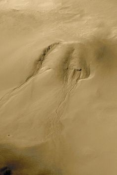 https://flic.kr/p/fqmUb2 | Evidence for Recent Liquid Water on Mars | Gullies eroded into the wall of a meteor impact crater in Noachis Terra. This high resolution view (top left) from the Mars Global Surveyor (MGS) Mars Orbiter Camera (MOC) shows channels and associated aprons of debris that are interpreted to have formed by groundwater seepage, surface runoff, and debris flow. The lack of small craters superimposed on the channels and apron deposits indicates that these features are…