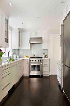 Bright, white kitchen with dark floors