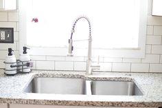 luna pearl granite with and white/grey subway backsplash