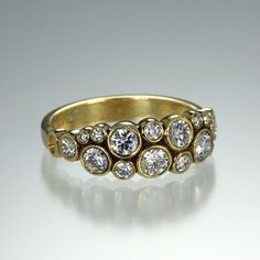 Sparkling diamonds and textured 18k gold combine to make this Alex Sepkus ring a true show stopper.
