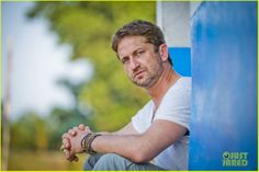 Gerard Butler just sittin' and chillin' (for a change!) during his recent visit to Liberia with Scottish charity Mary's Meals: December, 2013