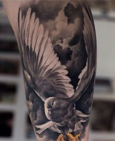 Amazing Flying Realistic Dove Tattoo