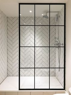 I'm in love with the herringbone tile and the amazing crittall shower screen from Creative Glass Studio in London Modern Bathroom Tile, Mosaic Bathroom, Bathroom Interior Design, Master Bathroom, Mosaic Tiles, Attic Bathroom, Shower Bathroom, Shower Window, White Bathroom